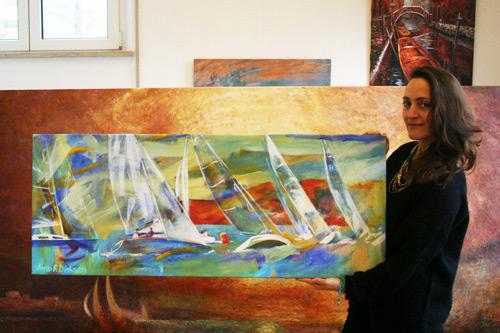 Kundin kaufte ein Leinwandbild mit modern ausgeführten Segelschiffen